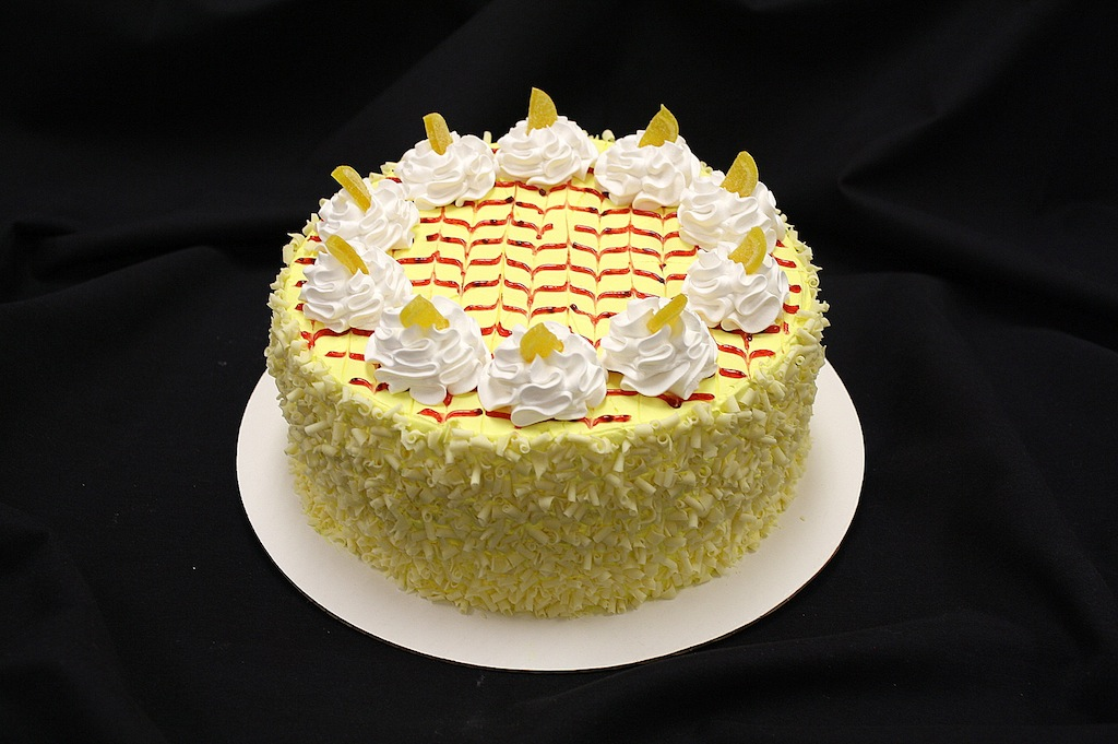 ... lemon cake filled with raspberry preserves and topped with airy lemon